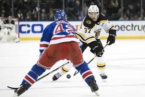 Bruins honor Bergeron with ceremony for 1,000th game
