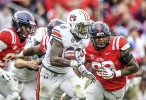 Whitlow rushes for 170 yards in Auburn's 31-16 victory