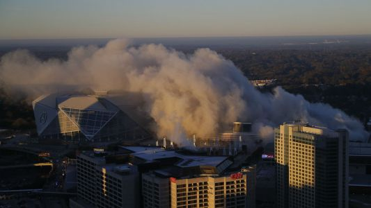 Watch: TV network's Georgia Dome implosion coverage photo bombed by city bus