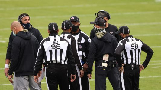 John Harbaugh, Ravens take exception to Titans' pregame huddle over logo