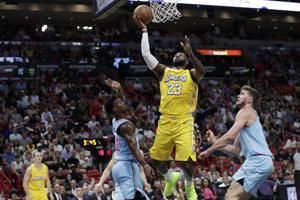 Davis, James lead Lakers to a 113-110 win over Heat