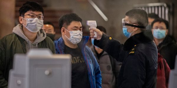 Airlines, hotels, and cruise lines sink as China's spreading coronavirus spurs travel anxiety