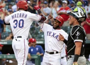 White Sox go small to beat Rangers 5-4 in 10 after 2 big HRs