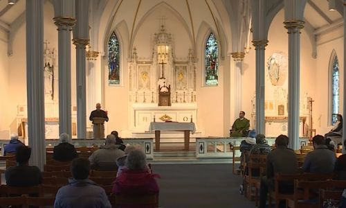 Harsh flu season leads to changes in Mass at Catholic churches