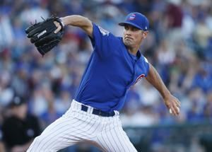 Cubs' Hamels gets hole-in-one, home run