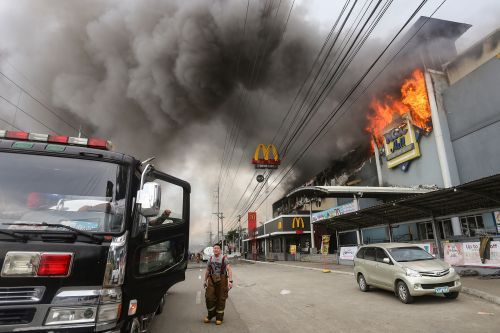 Dozens feared dead after mall fire in Philippines