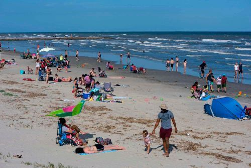 You probably won't catch the coronavirus from swimming. It's the crowds on the beach that matter