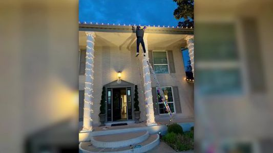Passerby panics, calls 911 after seeing 'Clark Griswold' hanging off roof