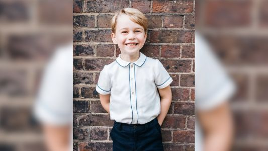 Prince George is one happy royal in his official birthday photo