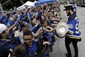 The Latest: Blues hoist Stanley Cup as St. Louis celebrates