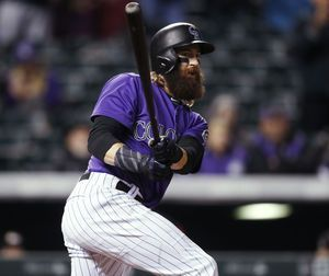 Rojas has 4 RBIs as Marlins beat playoff-hopeful Rockies 5-4