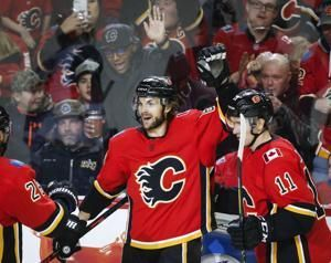 Giordano leads Flames to 5-2 win over Coyotes