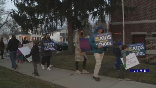 Parents in Geneva rally Monday night against hybrid learning option