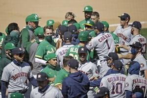 Astros, A's clear benches, empty seats; Oak wins 9th in row