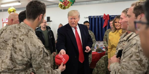 People have a lot to say about Trump signing MAGA hats for US troops in Iraq