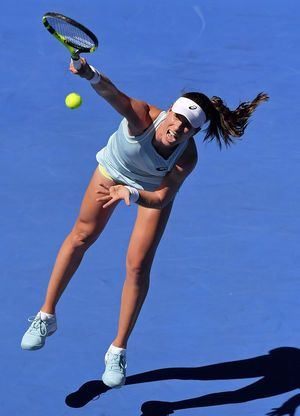 The Latest: Djokovic wins opening match at Australian Open