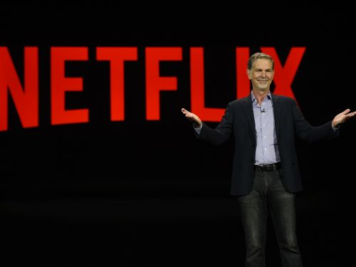Netflix hits a record high, passes Disney in size