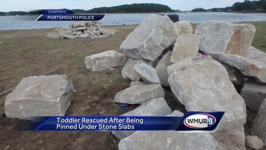 Officers rescue toddler trapped under rocks