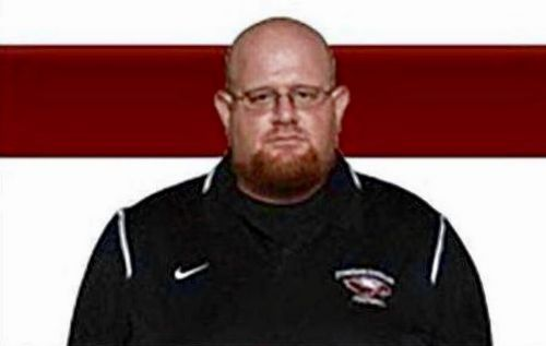 Football coach who 'selflessly shielded students from shooter' dies