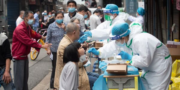 Photos show how Wuhan tested 6.5 million people for the coronavirus in 9 days, while the US has only tested 14 million people in 4 months
