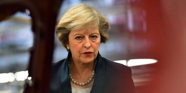 May heads for Brexit crunch talks following a day of Cabinet resignation chaos
