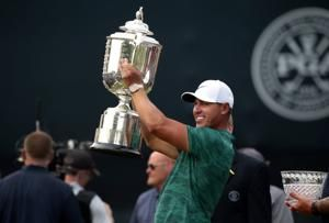 Unflappable Koepka holds off Tiger to win PGA Championship at Bellerive