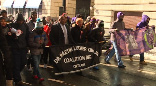 Hundreds brave cold for march in honor of MLK