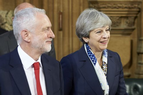 2 prominent Conservative MPs want Theresa May to work with Jeremy Corbyn to deliver Brexit
