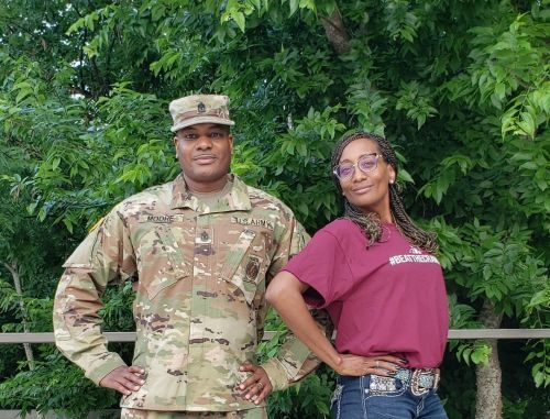 Army First Sergeant and Family, Sign with Crave Hot Dogs and BBQ!