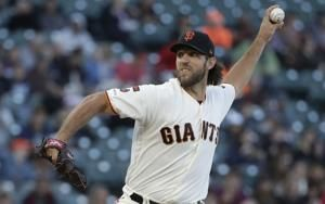 Bumgarner strikes out 11 in Giants' 4-2 win over Rockies