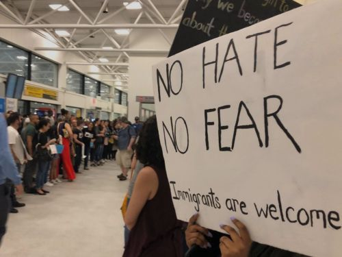 People gathered at LaGuardia Airport to greet children who were separated from their parents due to Trump's 'zero-tolerance' immigration policy