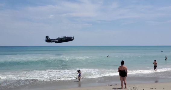 VIDEO: Plane crash lands in water on busy Florida beach during air show