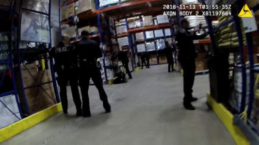 Intense lapel video of warehouse shooting released by APD