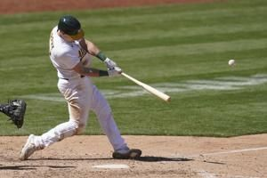 A's rally to beat Tigers in ninth, win eighth straight