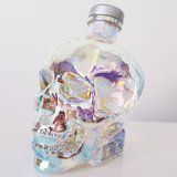 This Shimmery, Iridescent Skull Vodka Bottle Matches Your Soul