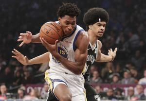 Warriors pick up fourth-year contract option on Damian Jones