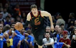 Kyle Korver's delicate balance: time to grieve, time to play
