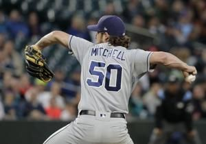 Padres get better of Edwin Diaz in 9th, beat Mariners 2-1