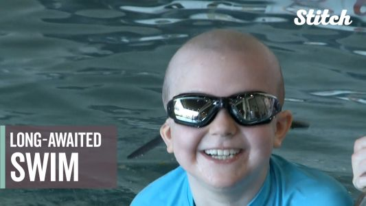 8-year-old girl with leukemia beams as she takes her first swim in a year
