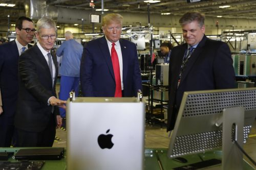 Trump said he's 'looking at' whether Apple should be exempt from China tariffs during visit to the company's facility in Texas