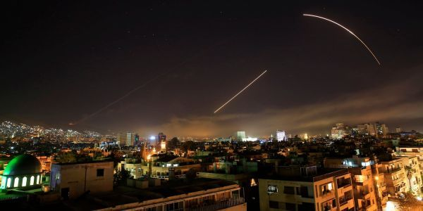 Photos of the Syria strike appear to show missile interceptors firing blindly, totally failing to stop missile attack