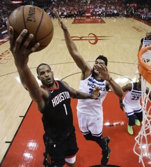Capela scores 26; Rockets eliminate Wolves with 122-104 win