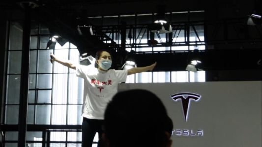 A Protester Was Dragged Away From The Tesla Booth At The Shanghai Auto Show
