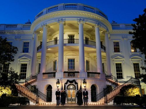 See pictures of the White House candlelight ceremony honoring the 500,000 Americans who died in the pandemic