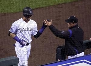 Rockies power up, snap home skid by beating Mets 10-8