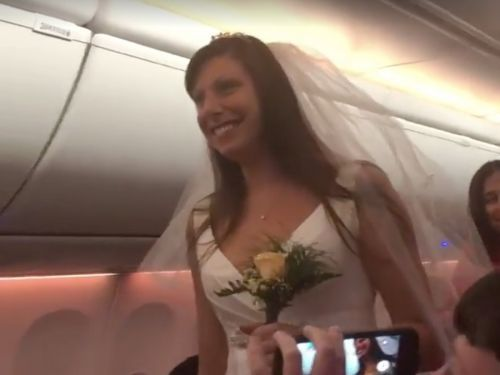 This couple got married in the middle of a Southwest Airlines flight - and the videos will convince you that true love exists