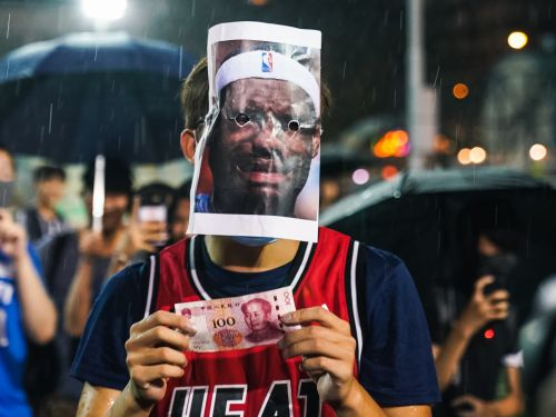 12 photos that show how Hong Kong protesters are wearing Winnie the Pooh, Guy Fawkes, and LeBron James masks to defy authority