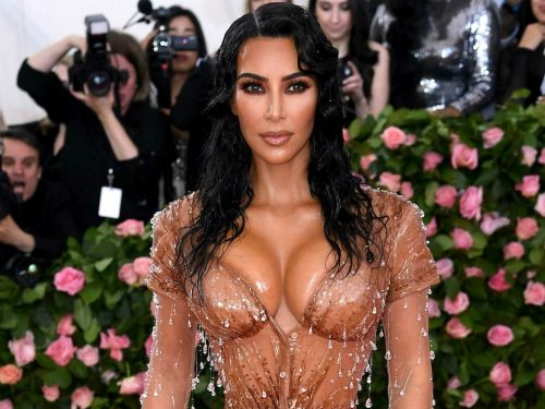 Kim Kardashian says her 2019 Met Gala dress was so tight that her sisters prepared to help her go to the bathroom