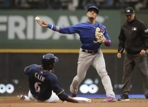 Cubs back in 1st, beat Brewers 7-2 in 11 innings