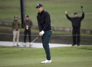 Holmes aces his way to 1st-round lead at Riviera